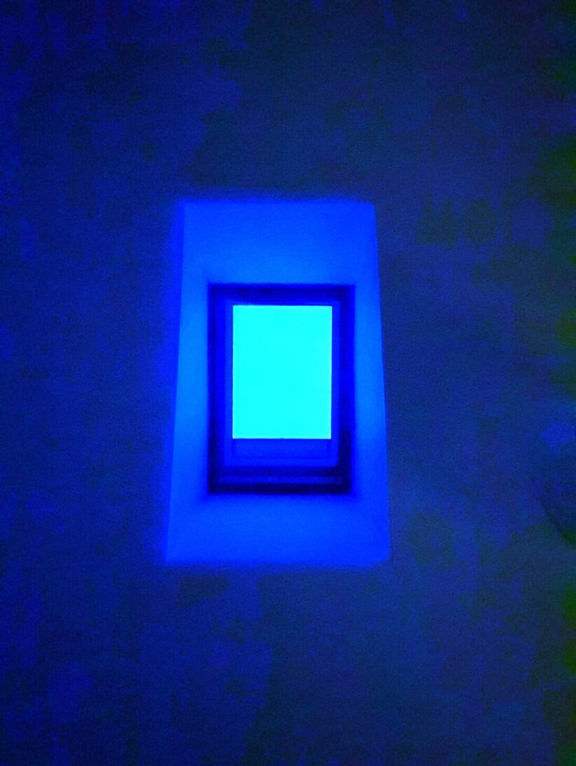 Turquoise skylight with electric blue ceiling.