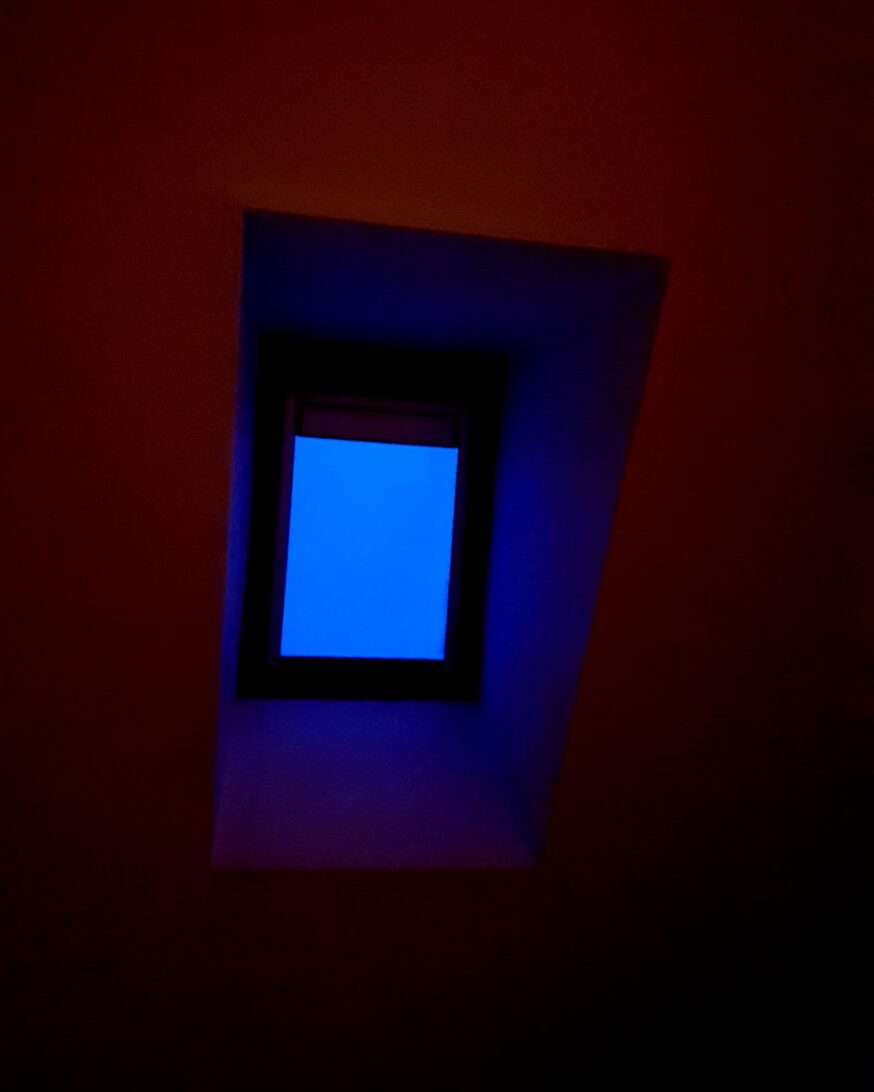 Blue skylight with red cieling