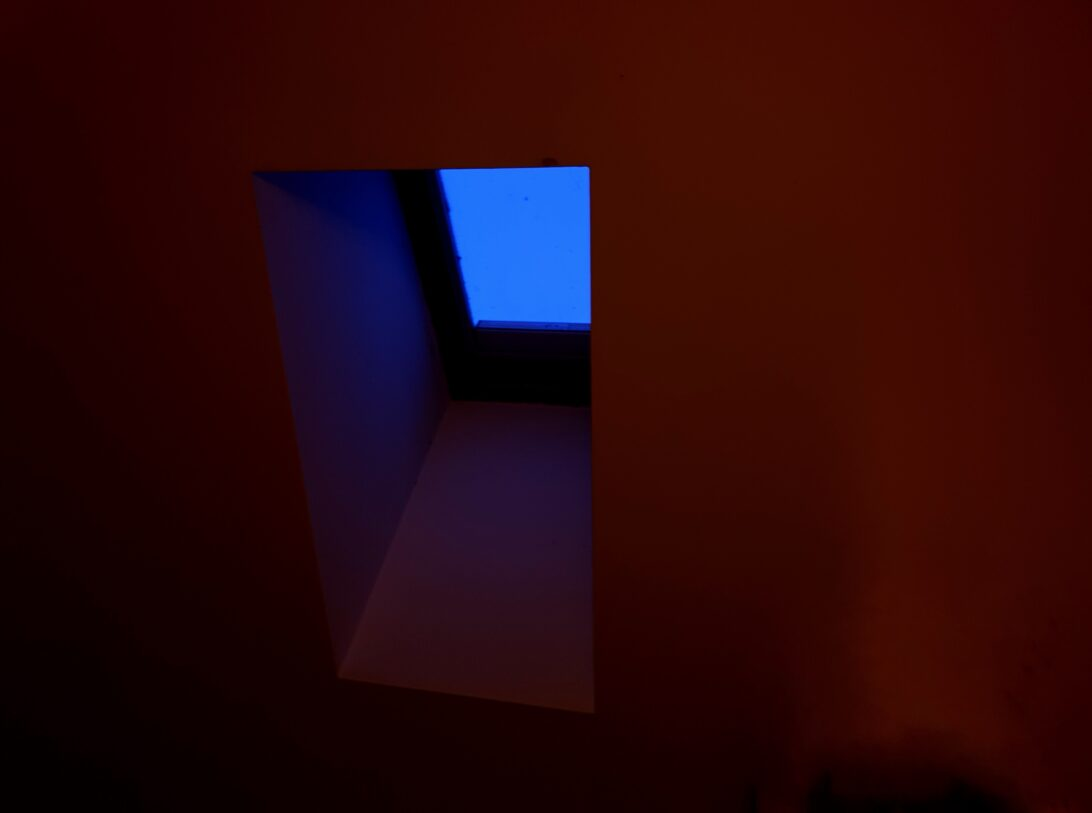 Blue skylight with russet ceiling.