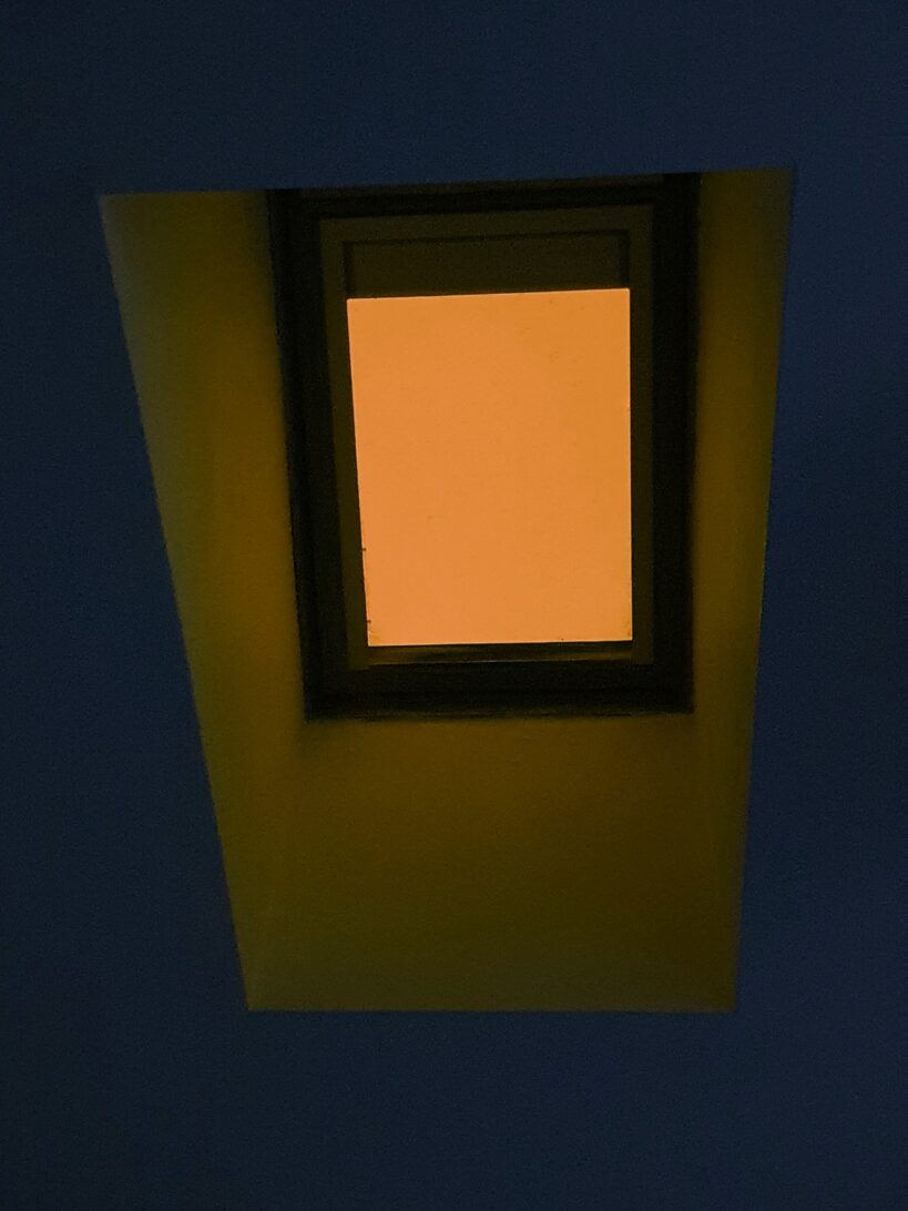 Yellow skylight with blue cieling