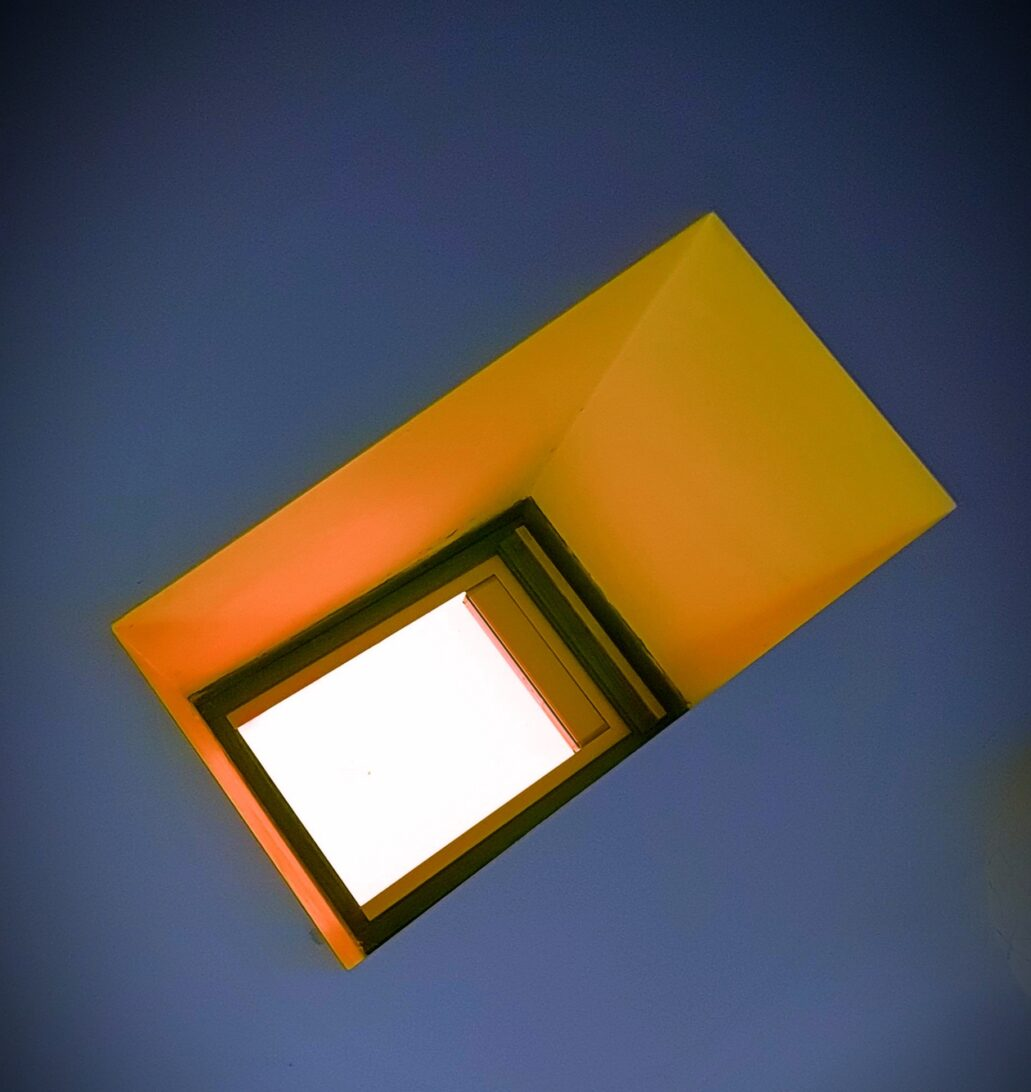 Whit skylight, orange inset with blue ceiling.